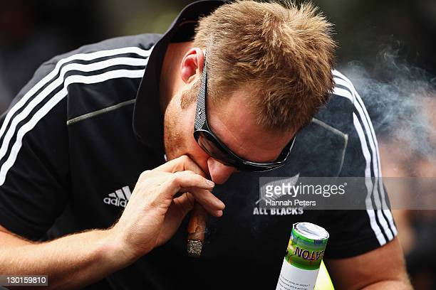 Ali Wiliams of the All Blacks smokes a cigar during the New Zealand All Blacks 2011 IRB Rugby World Cup celebration parade on October 24 2011 in...
