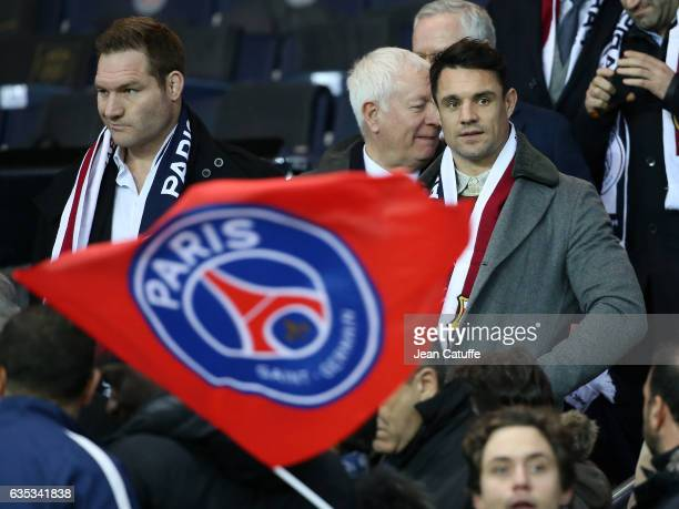 Ali Williams and Dan Carter attend the UEFA Champions League Round of 16 first leg match between Paris SaintGermain and FC Barcelona at Parc des...