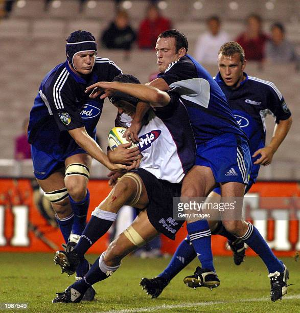 Ali Williams and Justin Collins of the Blues tackle William Stoltz of the Cats during the Super 12 match between the Cats and the Blues on May 2,...