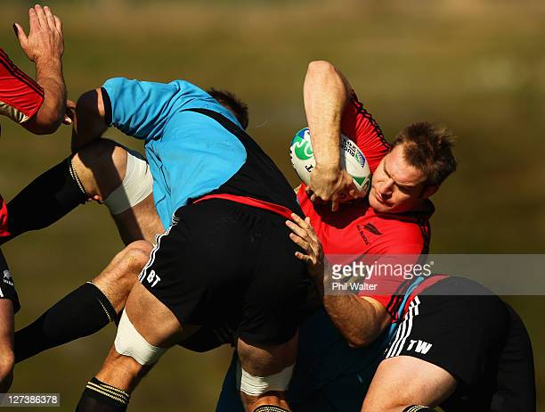 Ali Williams of the All Blacks is tackled during a New Zealand All Blacks IRB Rugby World Cup 2011 training session at Rugby League Park on September...