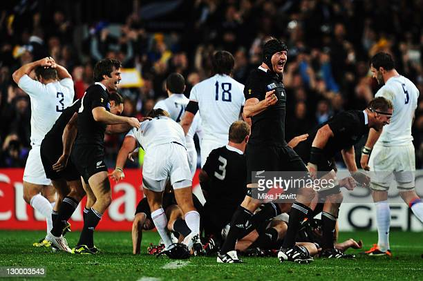 Ali Williams of the All Blacks jumps in the air as All Black payers celebrate after an 87 victory in the 2011 IRB Rugby World Cup Final match between...