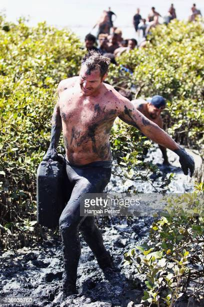Ali Williams of the Auckland Blues Super Rugby team competes in the Annual Naval Base Mud Run at the Devenport Naval Base on January 13 2012 in...