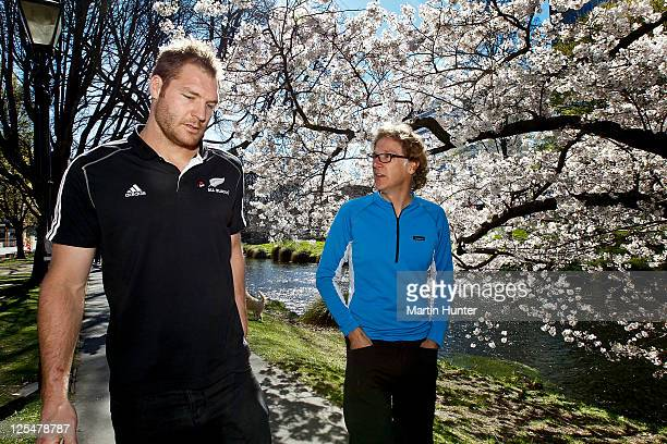 Ali Williams of the New Zealand All Blacks IRB Rugby World Cup 2011 team walks with Chief executive of Canterbury Earthquake Recovery Authority Roger...
