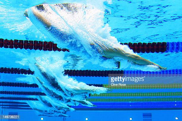 Alia Atkinson of Jamaica dives into the water at the start of the Women's 50m Freestyle heat 6 on Day 7 of the London 2012 Olympic Games at the...