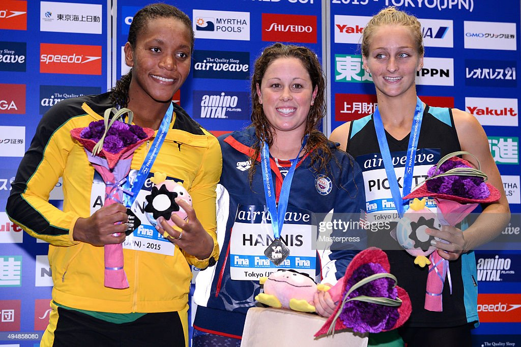 Alia Atkinson of Jamaica (Silver), Molly Hannis of the USA (Gold) and Leiston Pickett of Australia (Bronze) pose on the podium after the Women's 50m Breaststroke final during the FINA Swimming World Cup 2015 at Tokyo Tatsumi International Swimming Pool on October 29, 2015 in Tokyo, Japan.