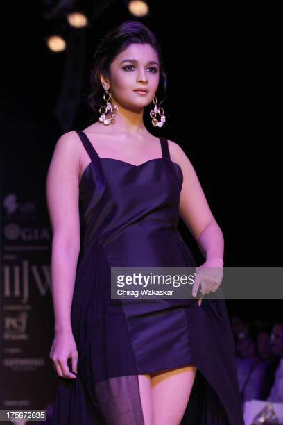 Alia Bhatt walks the runway at the Pallavi Foley show on day 3 of India International Jewellery Week 2013 at the Hotel Grand Hyatt on August 6 2013...