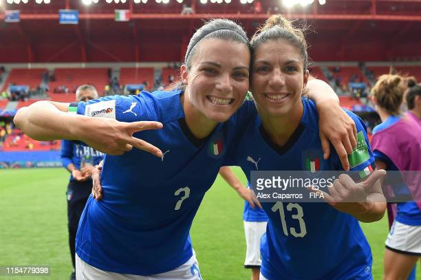 Alia Guagni and Elisa Bartoli of Italy pose for a photograph following victory in the 2019 FIFA Women's World Cup France group C match between...