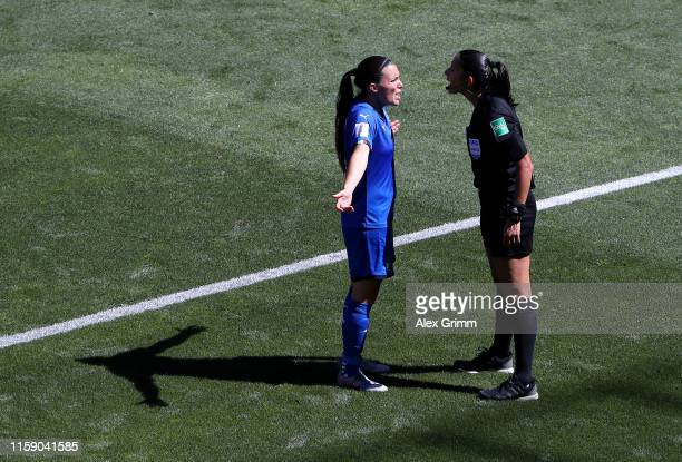 Alia Guagni of Italy argues with referee Claudia Umpierrez during the 2019 FIFA Women's World Cup France Quarter Final match between Italy and...