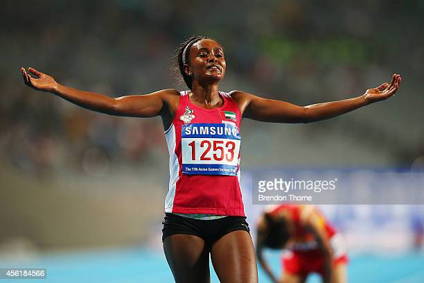 Alia Mohammed Saeed Mohammed of UAE celebrates claiming the Gold medal following the Women's 10,000m Final during day eight of the 2014 Asian Games...
