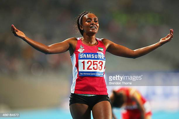 Alia Mohammed Saeed Mohammed of UAE celebrates claiming the Gold medal following the Women's 10000m Final during day eight of the 2014 Asian Games at...