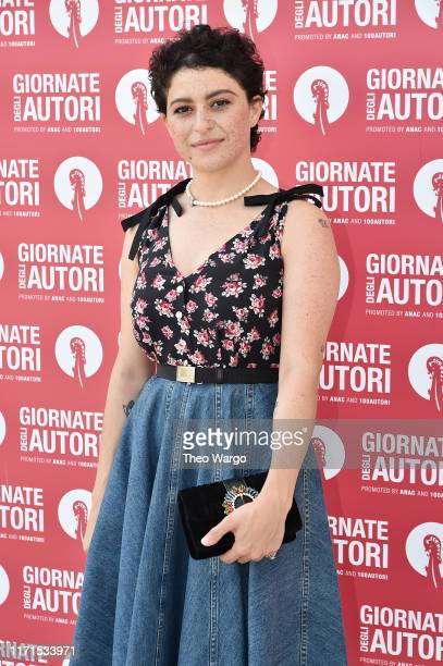 Alia Shawkat attends the MiuMiu photocall during the 76th Venice Film Festival at Sala Volpi on September 01 2019 in Venice Italy