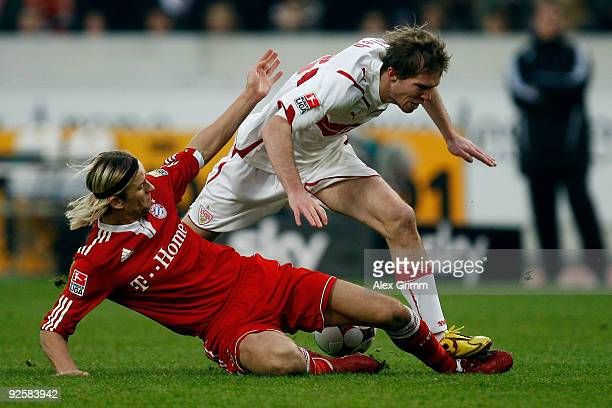 Aliaksandr Hleb of Stuttgart is challenged by Anatoliy Timoshchuk of Muenchen during the Bundesliga match between VfB Stuttgart and Bayern Muenchen...
