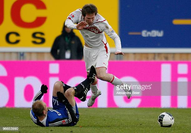 Aliaksandr Hleb of VfB Stuttgart fights for the ball with David Jarolim of Hamburger SV during the Bundesliga first division soccer match between VfB...