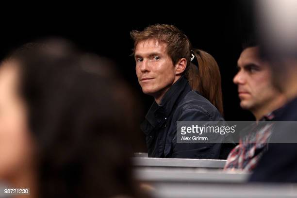Aliaksandr Hleb of VfB Stuttgart watches the first round match between Victoria Azarenka of Belarus and Flavia Pennetta of Italy at day three of the...