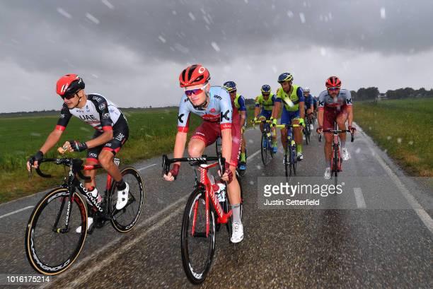 Aliaksandr Riabushenko of Belarus and Uae Team Emirates / Marco Mathis of Germany and Team KatushaAlpecin / Peloton / Rain / during the 14th...
