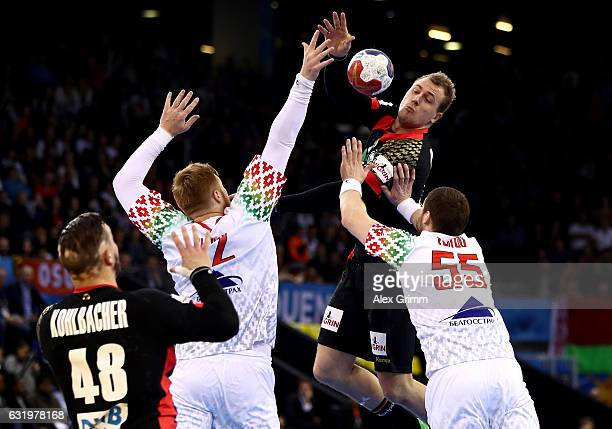 Aliaksandr Tsitou of Belarus challenges Julius Kuehn of Germany during the 25th IHF Men's World Championship 2017 match between Belarus and Germany...