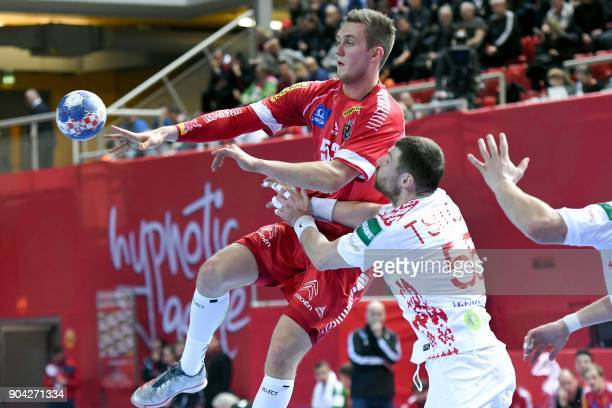 Aliaksandr Tsitou of Belarus vies for the ball with Mykola Bilyk of Austria during the preliminary round group B match of the Men's 2018 EHF European...
