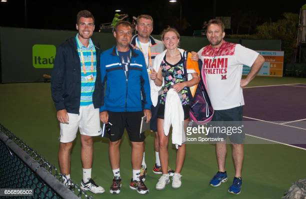 Aliaksandra Sasnovich and her team celebrate her birthday after defeating Alize Cornet during the Miami Open on March 22 at the Tennis Center at...