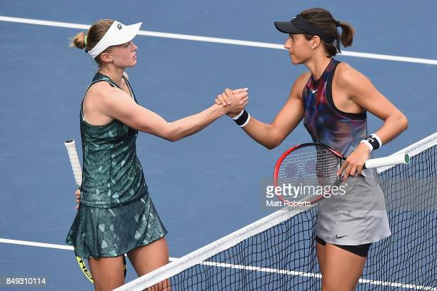 Aliaksandra Sasnovich of Belarus and Caroline Garcia of France shake hands after their match during day two of the Toray Pan Pacific Open Tennis At...
