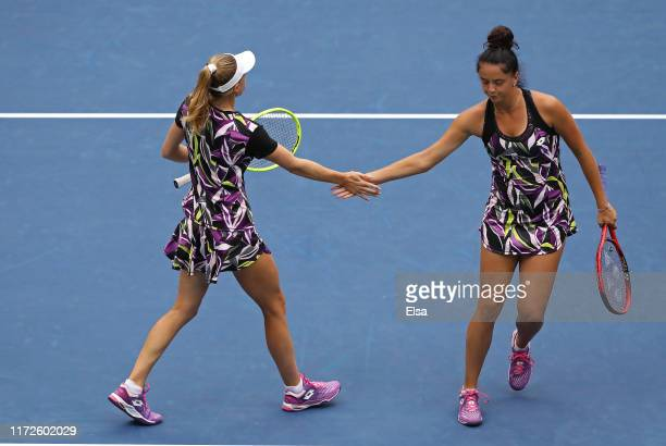 Aliaksandra Sasnovich of Belarus and Viktoria Kuzmova of Slovakia in action during their Women's Doubles semifinal match against Victoria Azarenka of...