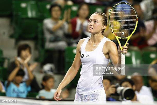 Aliaksandra Sasnovich of Belarus celebrates the winner Miyu Kato of Japan during women's singles match day one of the Toray Pan Pacific Open at...
