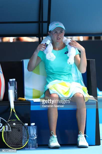 Aliaksandra Sasnovich of Belarus cools down between games in her third round match against Caroline Garcia of France on day six of the 2018...