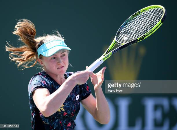 Aliaksandra Sasnovich of Belarus hits a forehand in her match against Caroline Wozniacki of Denmark during the BNP Paribas Open at the Indian Wells...