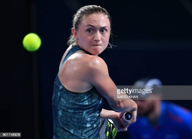 Aliaksandra Sasnovich of Belarus hits a return to Elina Svitolina of Ukraine during their women's singles final match at the Brisbane International...