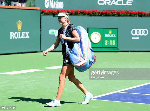 Aliaksandra Sasnovich of Belarus leaves the court after her match against Caroline Wozniacki of Denmark during the BNP Paribas Open at the Indian...