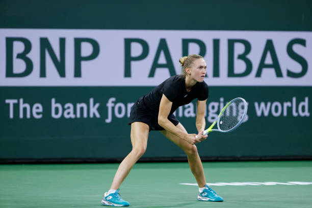 Aliaksandra Sasnovich of Belarus looks on during a match against Emma Raducanu of Great Britain during the BNP Paribas Open at the Indian Wells...