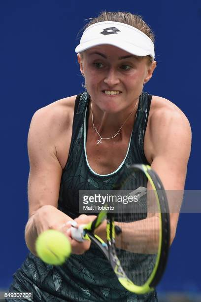 Aliaksandra Sasnovich of Belarus plays a backhand against Caroline Garcia of France during day two of the Toray Pan Pacific Open Tennis At Ariake...