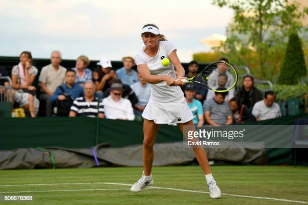 Aliaksandra Sasnovich of Belarus plays a backhand during her Ladies Singles first round match against Jelena Ostapenko of Latvia on day one of the...