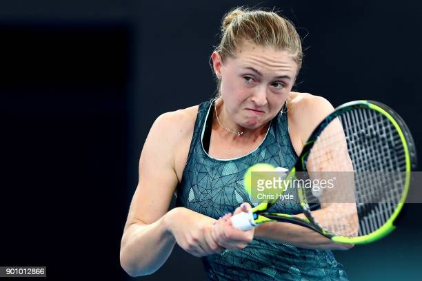 Aliaksandra Sasnovich of Belarus plays a backhand in her match against Alize Cornet of France during day five of the 2018 Brisbane International at...