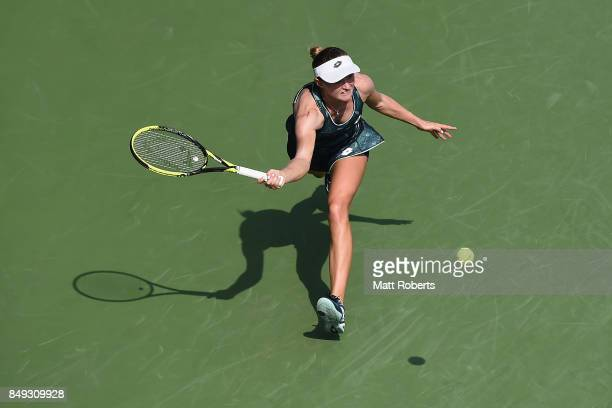 Aliaksandra Sasnovich of Belarus plays a forehand against Caroline Garcia of France during day two of the Toray Pan Pacific Open Tennis At Ariake...