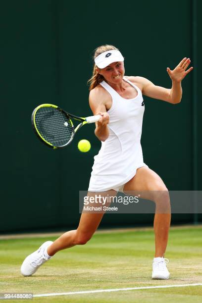 Aliaksandra Sasnovich of Belarus plays a forehand against Jelena Ostapenko of Latvia during their Ladies' Singles fourth round match on day seven of...