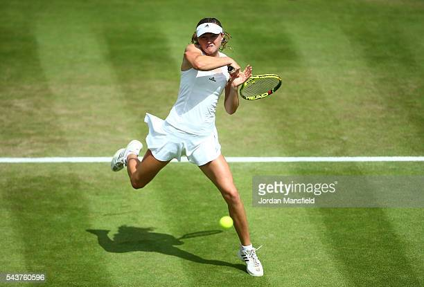Aliaksandra Sasnovich of Belarus plays a forehand during the Ladies Singles first round match against Kristina Mladenovic of France on day four of...