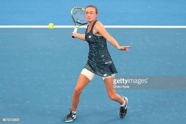 Aliaksandra Sasnovich of Belarus plays a forehand in her match against Alize Cornet of France during day five of the 2018 Brisbane International at...