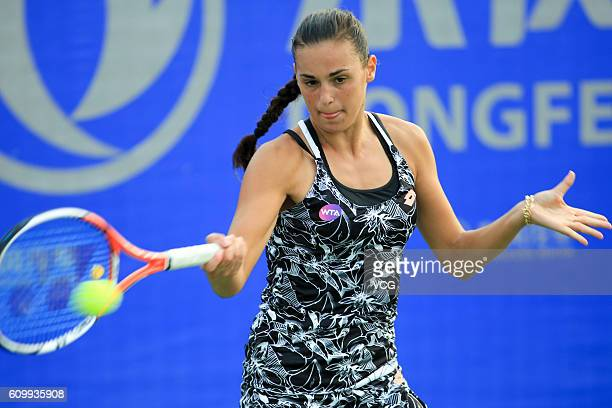 Aliaksandra Sasnovich of Belarus returns a shot against Duan Yingying of China during the qualifying match of 2016 WTA Dongfeng Motor Wuhan Open at...