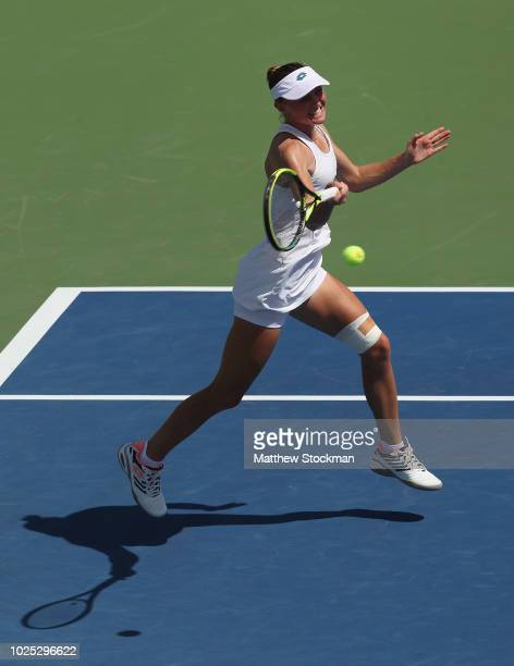 Aliaksandra Sasnovich of Belarus returns a shot during her women's singles second round match against Daria Kasatkina of Russia on Day Four of the...