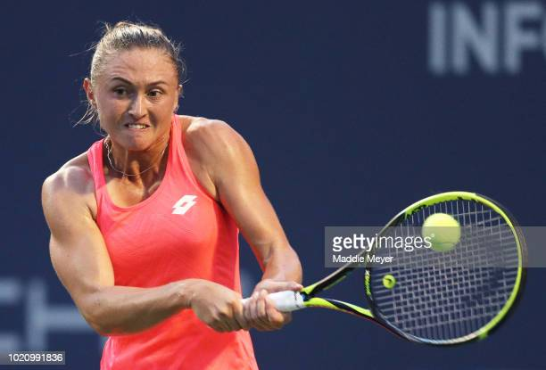 Aliaksandra Sasnovich of Belarus returns a shot to Caroline Garcia of France during Day 2 of the Connecticut Open at Connecticut Tennis Center at...