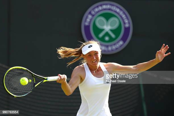 Aliaksandra Sasnovich of Belarus returns against Petra Kvitova of Czech Republic during their Ladies' Singles first round match on day two of the...