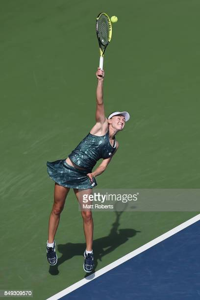 Aliaksandra Sasnovich of Belarus serves against Caroline Garcia of France during day two of the Toray Pan Pacific Open Tennis At Ariake Coliseum on...