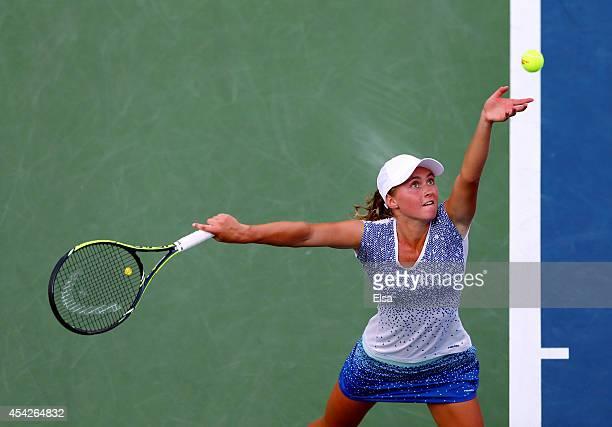 Aliaksandra Sasnovich of Belarus serves against Caroline Wozniacki of Denmark during their women's second round match on Day Three of the 2014 US...