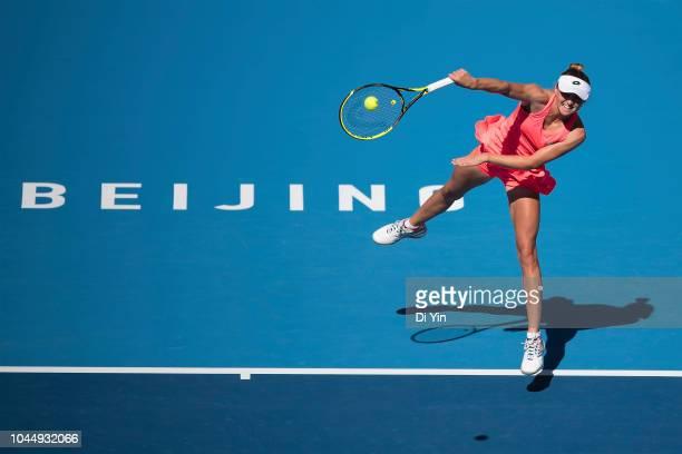 Aliaksandra Sasnovich of Belarus serves to Karolina Pliskova of the Czech Republic during her women's singles second round match at the China...