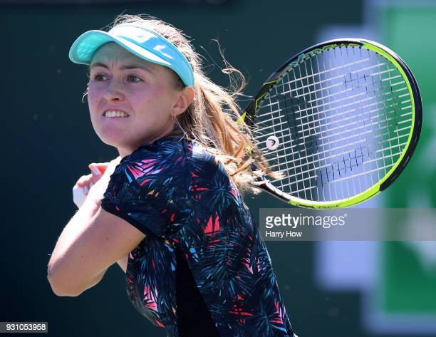Aliaksandra Sasnovich of Belarus watches hr backhand in her match against Caroline Wozniacki of Denmark during the BNP Paribas Open at the Indian...