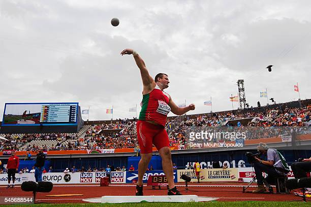 Aliaksei Nichypor of Belarus in action during the qualifying round of the mens shotput on day four of The 23rd European Athletics Championships at...