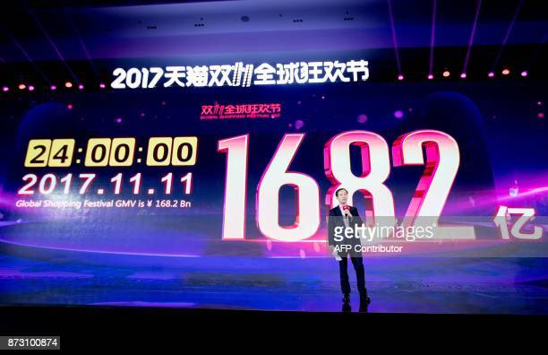 Alibaba CEO Daniel Zhang speaks in front of a screen showing total sales at over 168 billion yuan shortly after the end of the 1111 or Singles Day...