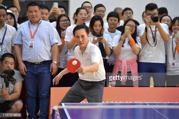 Alibaba CEO Daniel Zhang Yong plays table tennis with table tennis player Zhang Jike at Alibaba headquarters on June 21, 2019 in Hangzhou, Zhejiang...