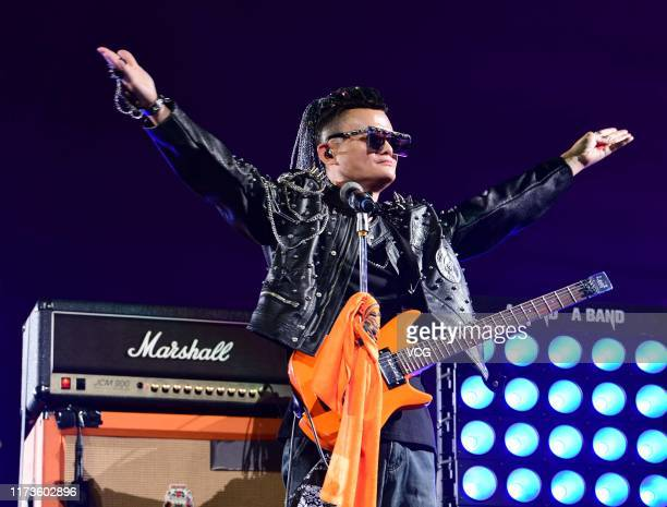 Alibaba founder Jack Ma performs on the stage during Alibaba's 20th anniversary gala at Hangzhou Olympic Center Stadium on September 10 2019 in...