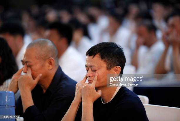 Alibaba Group Chairman Jack Ma and actor Jet Li do eye exercises during Jack Ma Foundation Rural Teachers Awards on January 22 2018 in Sanya China...